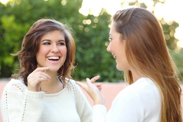 Two Young Women Talking Outdoor
