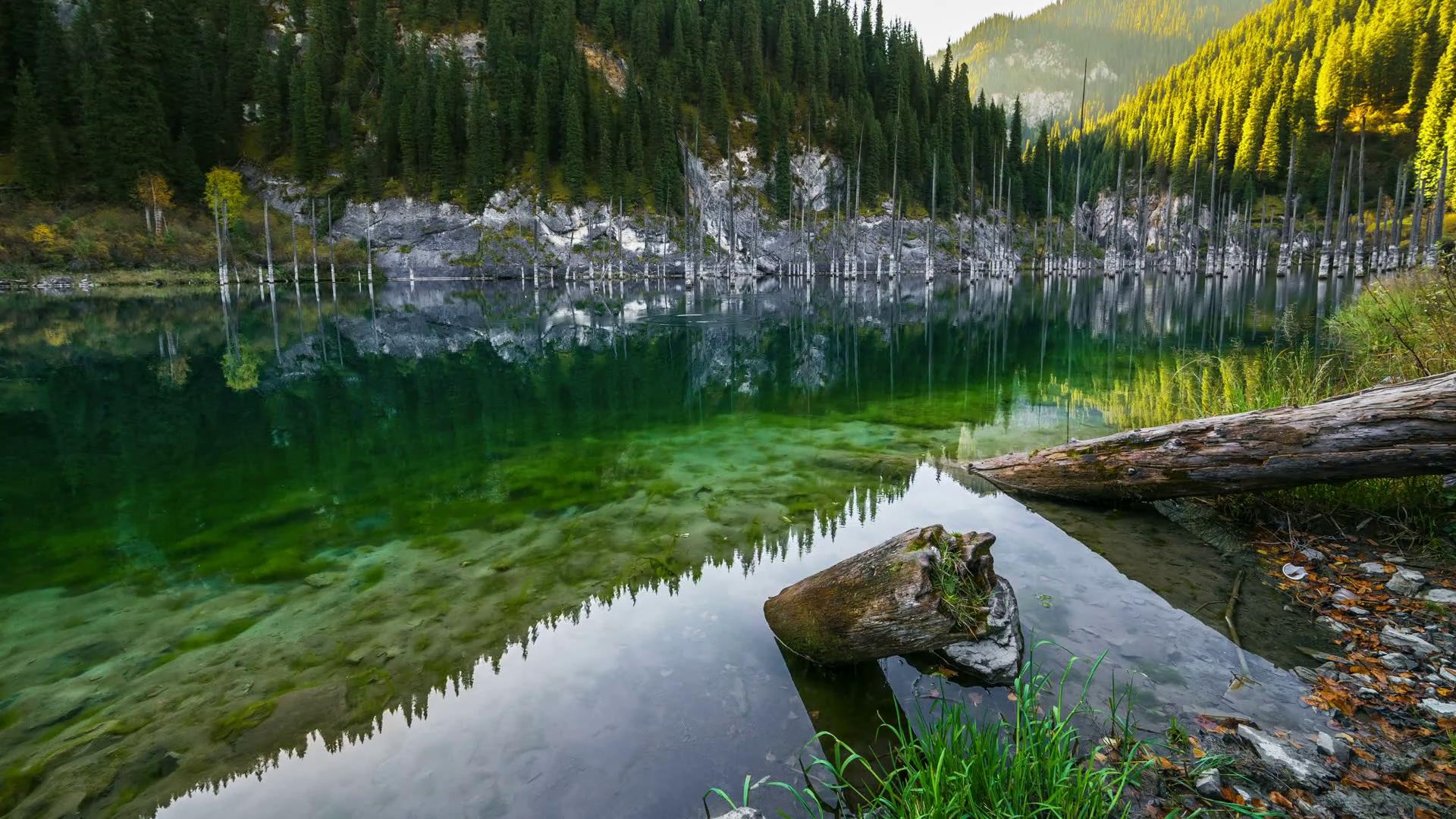 majestic-mountain-lake-kaindy-in-mountains-kazakhstan-4k-timelapse-september-2016-almaty-and-astana-kazakhstan_r0jdgdtjg